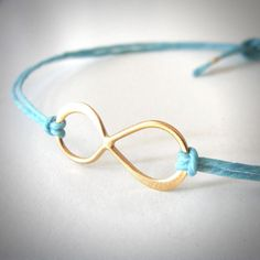 Gold Vermeil Infinity bracelet on colored linen (you choose!) by JewelryByMaeBee on Etsy