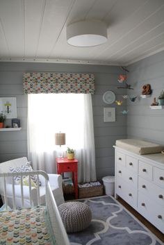Gender neutral nursery with painted paneling.
