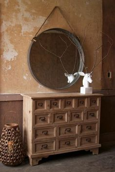 round mirror with heavy iron frame and rope hanger   At West End $469