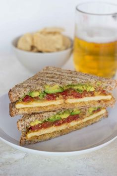 "Smashed Chickpea, Avocado and Roasted Tomato Sandwich with ""Cheesy"" Tofu - Vegetarian & Vegan Recipes http://veggiefocus.com #vegan #sandwich #Recipe"