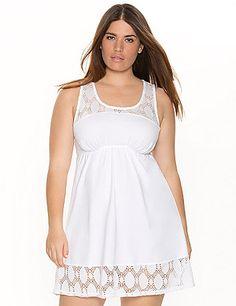Feminine eyelet trim makes our soft knit chemise a charming way to end your day. You'll look as good as you feel in this cozy cotton lounger, featuring a scoop neck and racer back, plus an elastic seamed waist to flatter your curves.#LaneBryant #Cacique