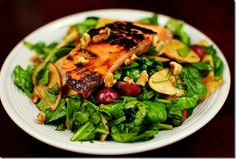 Salmon with Salad and Raspberry dressing.