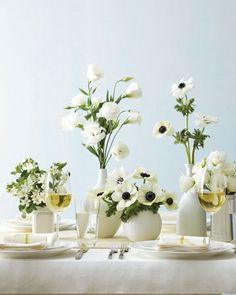 Inexpensive bottle spray-painted white. #bottles #centerpiece #flowers