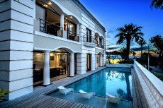 Timeless elegance personified.  This gracious double storey home situated in Fresnaye, Cape town.   With charming balconies, Jacuzzi and pool with 360 degree sea and mountain views with luxurious finishes.