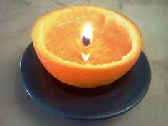 Orange Candle. So clever! Just take an orange/lemon/grapefruit, cut in half, eat the middle portion, leave the center core-like stem intact. Pour a kitchen oil (veg oil,olive oil, etc) into orange just below the top of the stem. Light stem. It will burn for hours and smell amazing.