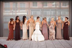 Long Bridesmaids Dresses. I would let each bridesmaid choose their own shade of brown dress but have then all wear the same color flower