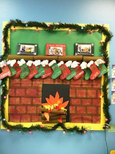 December/Christmas prek bulletin board. We made the cards on the mantel with pictures of our students.