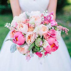 Coral and Cream Bouquet | Juliet garden roses, ranunculus, poppies, peonies, sweet peas, and hydrangea came together in this coral and cream bouquet. | SouthernLiving.com