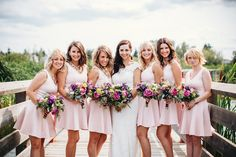pink bridesmaid dresses, photo by David Guenther http://ruffledblog.com/leduc-stone-barn-wedding #bridesmaids #bridesmaiddresses
