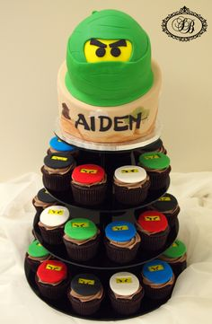 Lego ninjago cake and cupcakes boys birthday. this has aiden written all over it....yeah, that was bad lol