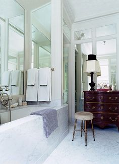 Mirrors in molding- 9 Ways to Fake Extra Square Footage With Mirrors #theeverygirl