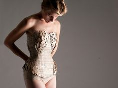 Corset made of Wood that us meant to resemble snakeskin, Designed by Stephanie Nieuwenhuys chips, fashion weeks, organic cotton, wood chip, corsets, recycled wood, stefani nieuwenhuys, london fashion, green fashion