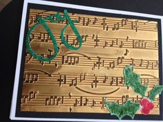 Christmas card using sizzix sheet music embossing folder, sizzix holly and berries sizzlit, and sizzix joy sizzlit