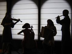 Night music photography picture - silhouette painting? Kids pick instrument, take photo, cut out to use as stencil for silhouette...one man band?