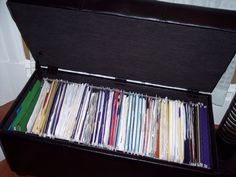 Before and After: Heather's Filing System | Apartment Therapy Padded bench from Target with filing insert.