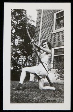 vintage photo of a woman with a bow and arrow ca. 1940s