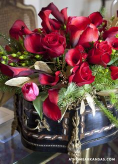 Exquisite Classic red Roses & elegant Calla Lilies adds romance & sophistication!