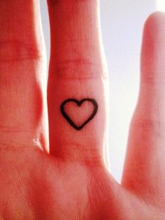Simple heart finger tattoo. I am too chicken to ever do this but I would love to