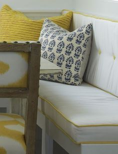 banquette Boxed cushion with larger diameter contrast welt and shallow button tufts.