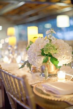 Hydrangea Centerpiece - just a touch of green. See the wedding here: http://www.StyleMePretty.com/2014/05/15/elegant-white-wedding-in-georgia/ HarwellPhotography.com - #SMP - Floral Design: ByTulip.com