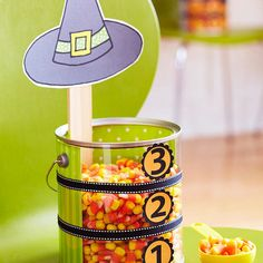 Cute game for halloween party... candy corn relay, first team to fill their bucket to 3 wins! :)