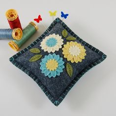 Wool Felt Flower Pincushion - Blue, Yellow & Ivory by TheBlueDaisy, via Flickr