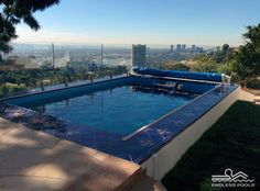 What makes this Endless Pool® installation stand out? The bold blue tile coping. The unobtrusive see-through protective barrier. The sprawling view of downtown Los Angeles.  For fun, fitness, swimming, and entertaining, make your Endless Pool a standout. You'll get ideas and planning tips when you request a Free Idea Kit from www.endlesspools.com.