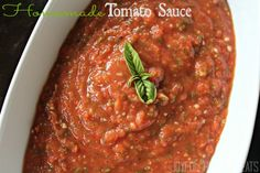 Homemade Tomato Sauce with only has 3 ingredients - roma tomatoes, roasted garlic, and fresh basil leaves.
