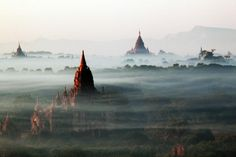 Beautiful buildings peek out from the mist in Bagan, Myanmar.