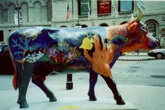 Aquarium Cow :-)    ~The Chicago Department of Cultural Affairs presented Cows on Parade. Cows, not real ones, but fiberglass-facsimiles of life-sized cows, 300 of them, were painted, decorated, immortalized and set out to graze around downtown Chicago for the public's enjoyment.  In other words, it was a public display of art on the hoof.