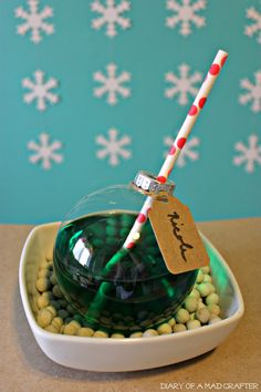 Ornament Drinking Glass -FULL TUTORIAL-Just pop you favourite holiday drink or shot inside, add a straw, and a label if you like and you are done looks awesome and is defiantly an eye catcher at any Christmas party :)