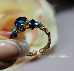 This is awesome for ladies with large knuckles like me. Wire_Wrap_Jewelry: View Photo: finished ring 30x10 aquamarine 1