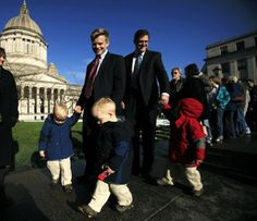 Rep. Jamie Pedersen and his partner Eric Pedersen walk to a hearing on gay-marriage legislation with their four children Leif, 2, left, Anders, 2, center, Erik, 2, red, and Trygve, 4, (behind, not pictured) Monday, Jan. 23, 2012 in Olympia, Wash. The Pedersen family was on their way to testify for HB 2516. (Photo: ERIKA SCHULTZ / THE SEATTLE TIMES)