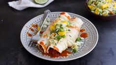 These enchiladas are like no other – stuffed with chorizo and chicken, and topped with mango and avocado slaw!