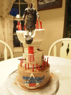For the Birthday Assassin's 35th birthday. A homemade Assassin's Creed Ezio Auditore triple chocolate cake.