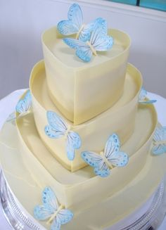 Blue butterfly and white chocolate wedding cake