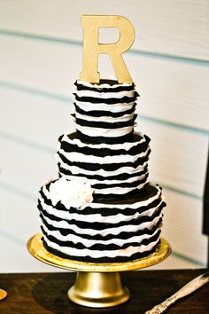 black, gold and white cake