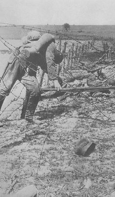 A Dead German Soldier trapped on Barbed wire at The Eastern Front during WWI.