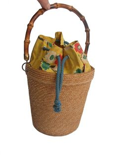 1950 FRENCH straw bucket , bamboo handle   https://www.etsy.com/listing/197822009/50s-french-basket-handbag-straw-and?ref=shop_home_active_1