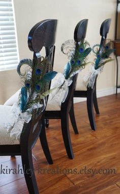 $28 pre-made...PEACOCK PEW BOWS -- Ceremony Aisle Decoration, Bride and Grooms / Wedding Party Reception Chair Bows Decor -- Customized In Your Colors. $28.00, via Etsy.