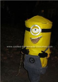 Minion costume made with a yellow collapsible laundry hamper....hmmm??