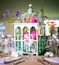 15 Non-Floral Centerpieces So Stunning, You Won't Miss Flowers  Cut down on your wedding costs by nixing expensive flower arrangement centerpieces and opting for something more unique.  By:   Kelsie Allen and Shih Mei Kong  Bird Cages    For a garden wedding with a rustic feel, display large, colorful bird cages on tables for a simple, yet eye-catching, centerpiece. Weave ivy or a few flowers into the cage if you choose, or set a few candles inside to create a more intimate mood.     birdcage we