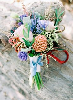 exotic bouquet for destination wedding #bouquet #bride #weddingchicks http://www.weddingchicks.com/2014/03/05/beach-town-wedding/