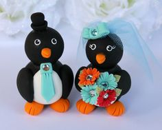 Custom wedding cake topper penguin Tiffany blue - love birds bride and groom - gerber daisies bouquet. $86.00, via Etsy.