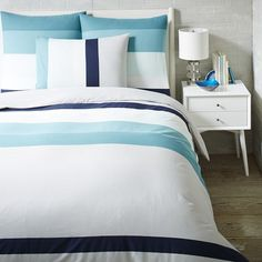 The graduated colorblock pattern on our Stepped Stripe Duvet Cover + Shams features one accent stripe in bold navy to wake up your look. To vary your look from day to day, you can even arrange it horizontally or vertically.