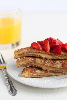 Peanut Butter Stuffed French Toast topped with fresh strawberries! A playful spin on PB&J! | LoveGrowsWild.com