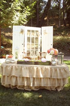 burlap table cover...good idea for cake table and maybe the bride and groom table