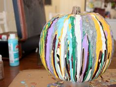 Forget traditional pumpkin carving, here's a messy, colorful Halloween craft to try -- Drip Paint Pumpkins. Fun Tip: let your little ones pick out the paint and glitter colors!