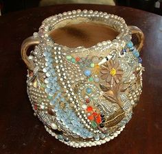 Memory Pot - is a piece of pottery covered in clay and encrusted with heirloom treasures like costume jewelry, keys or vintage trinkets