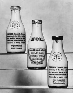 "Adohr Farms' Certified Milk in bottles shown with their guarantee on the back, circa 1935-1937. Accompanying caption reads: ""On every Certified Bottle is this guarantee of purity. Certified Milk is produced clean, kept clean and delivered clean. No other milk is produced under such rigid and far-reaching regulations."" Adohr Farms Collection."